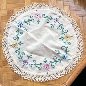 Charming embroidered linen doily